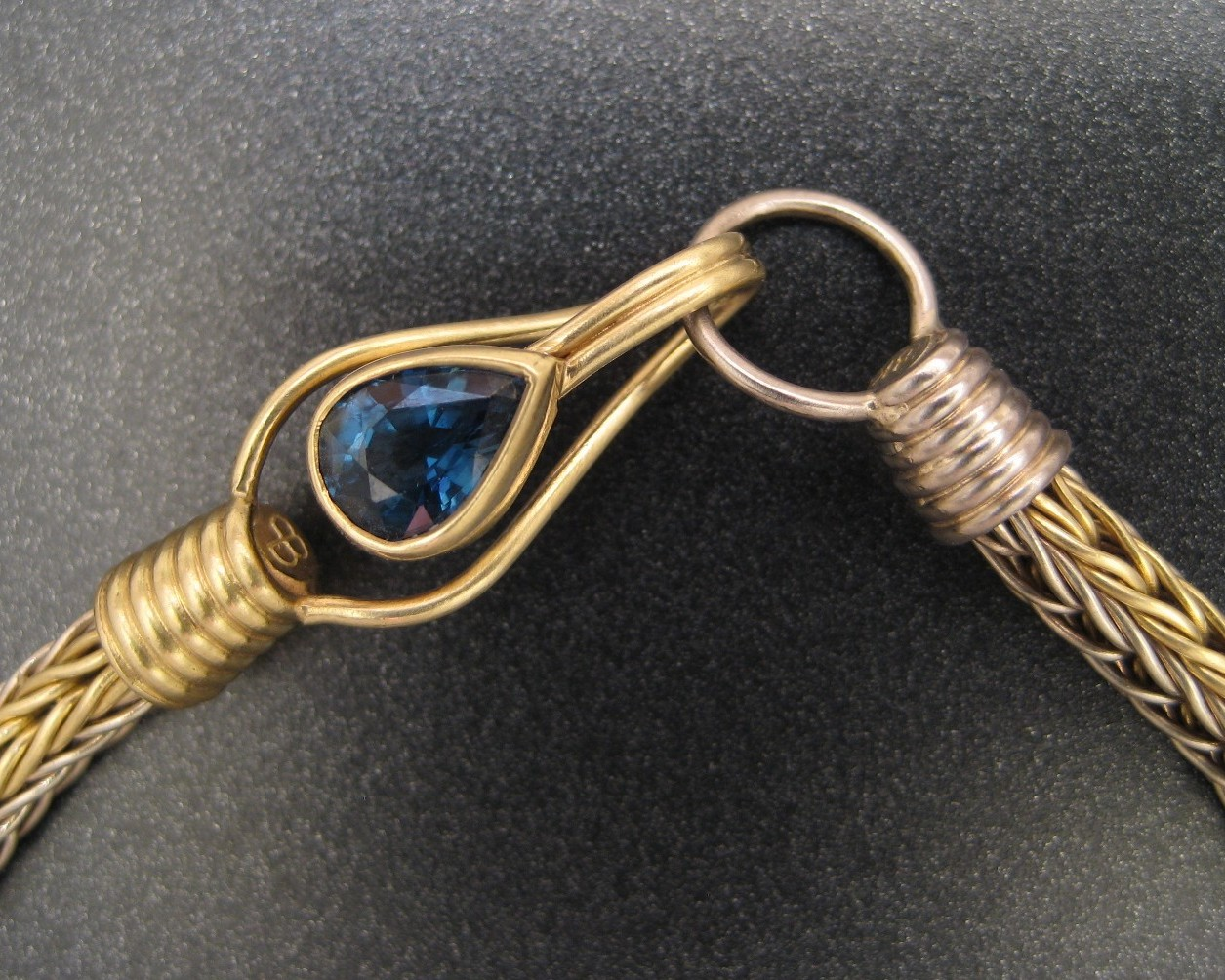 A closeup of a finished Roman Chain now mounted on a custom clasp and set with a fine Sapphire.