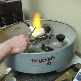 I am now heating the crucible with the fine gold.