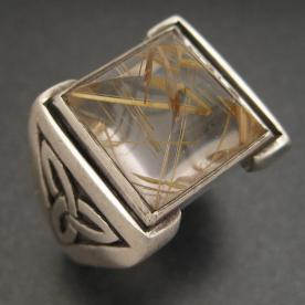 Celtic ring with custom cut rutilated quartz