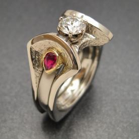Custom wedding ring with diamond and rubies built as a modular ring.