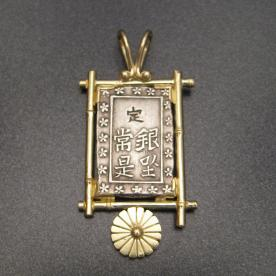 Japanese silver coin mounted as jewelry.