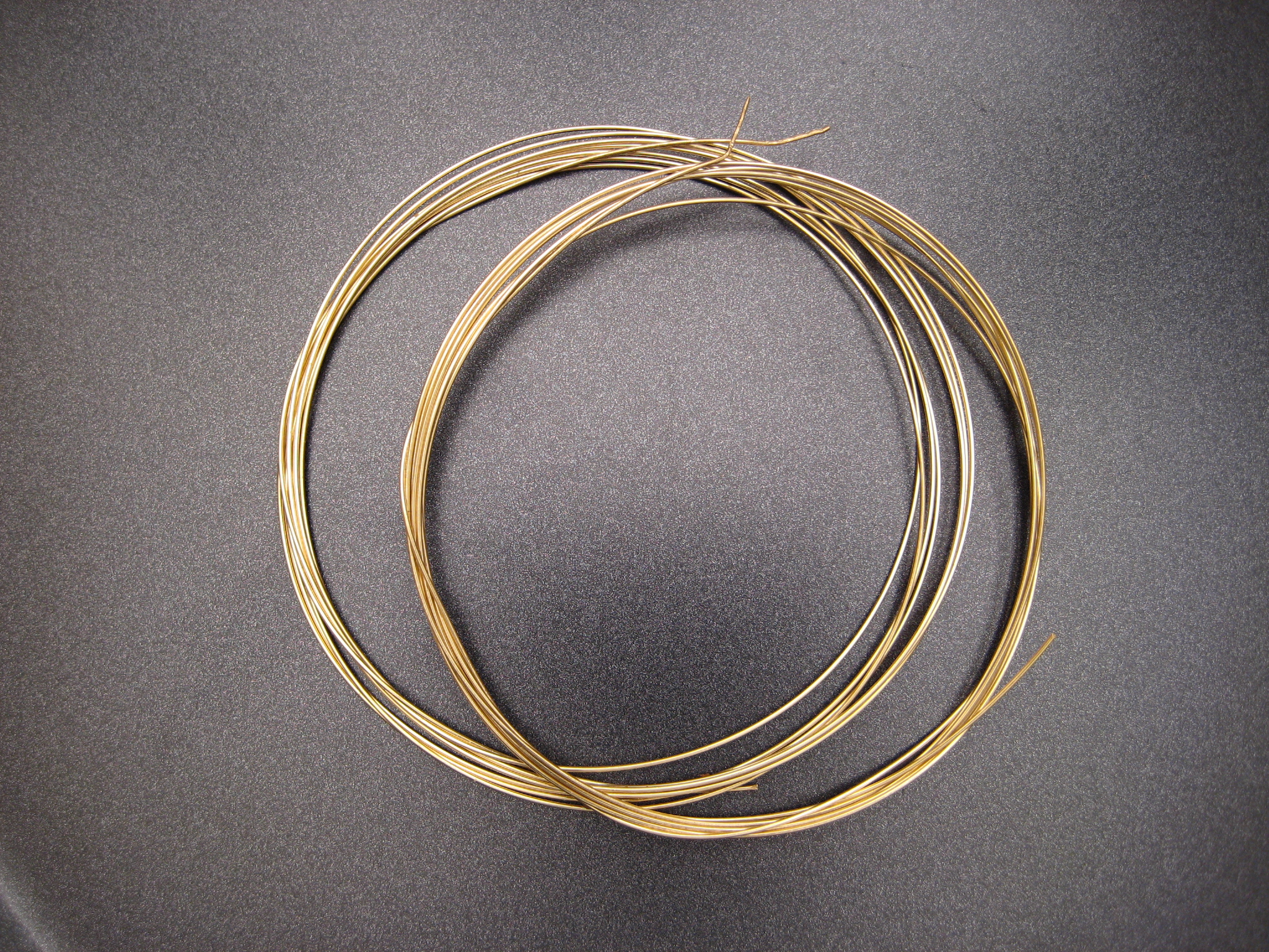 Spools of 18K gold wire after pulling and annealing.