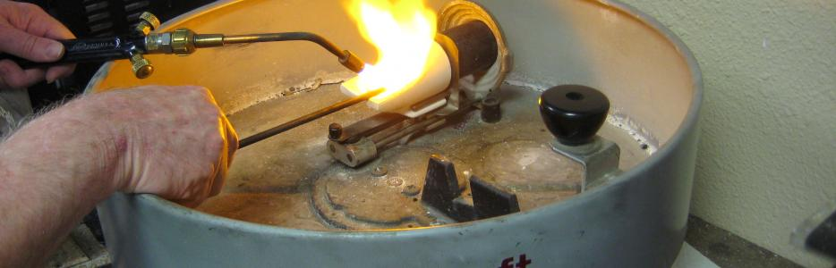 I am now stirring the gold to distribute the alloy metals and preparing to spin the centrifuge.
