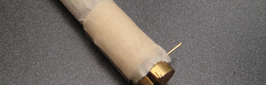 The wire has been wrapped around the mandrel and has been taped to hold it firm.